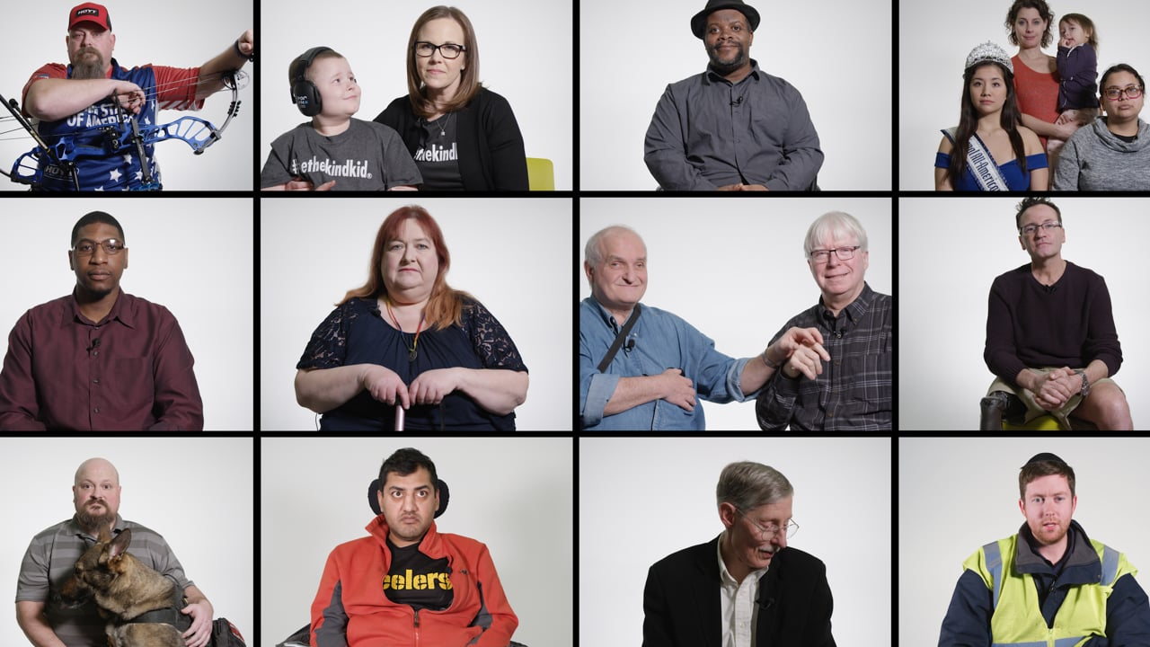 Composite video thumbnail of twelve different people with disabilites. Some are with their families. Some are signing. One has a bow and arrow, one has a cane, one is a a wheelchair, and one has a dog.